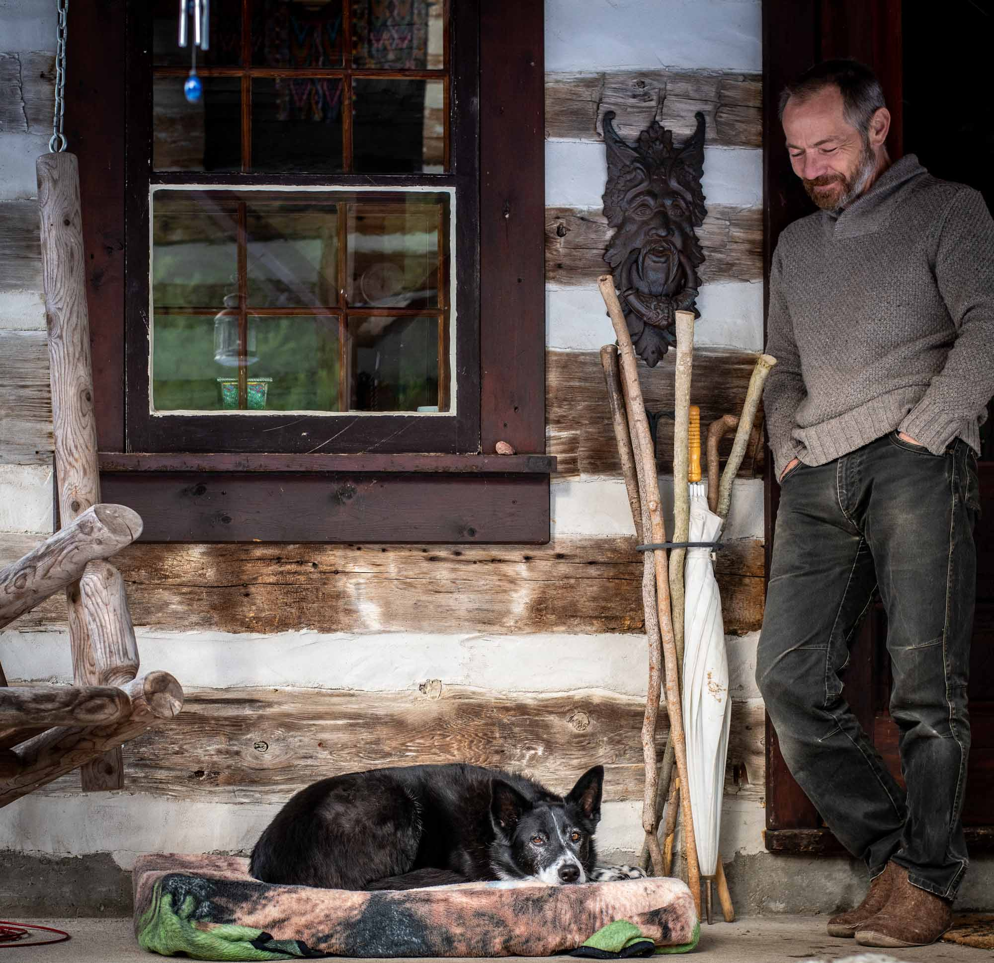The-Cordwood-Cabin-An-Accessible-Retreat-from-the-21st-Century-Neil-Baldwin-standing-photo-by-Kristin-Schnelten
