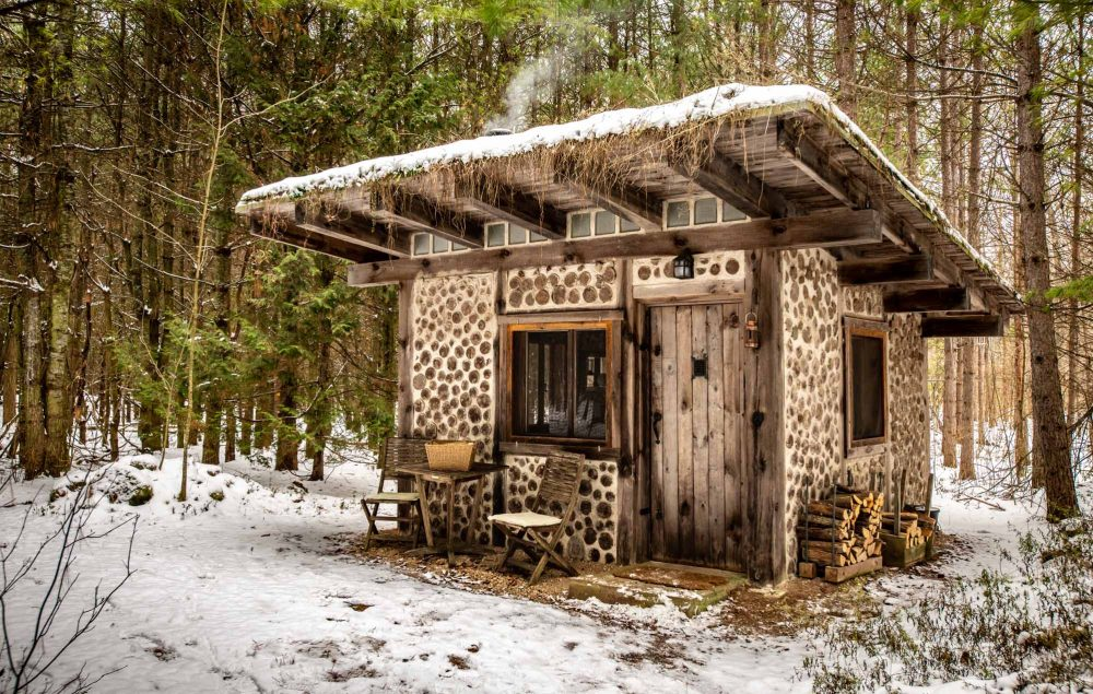 The-Cordwood-Cabin-An-Accessible-Retreat-from-the-21st-Century-cabin-exterior-photo-by-Kristin-Schnelten