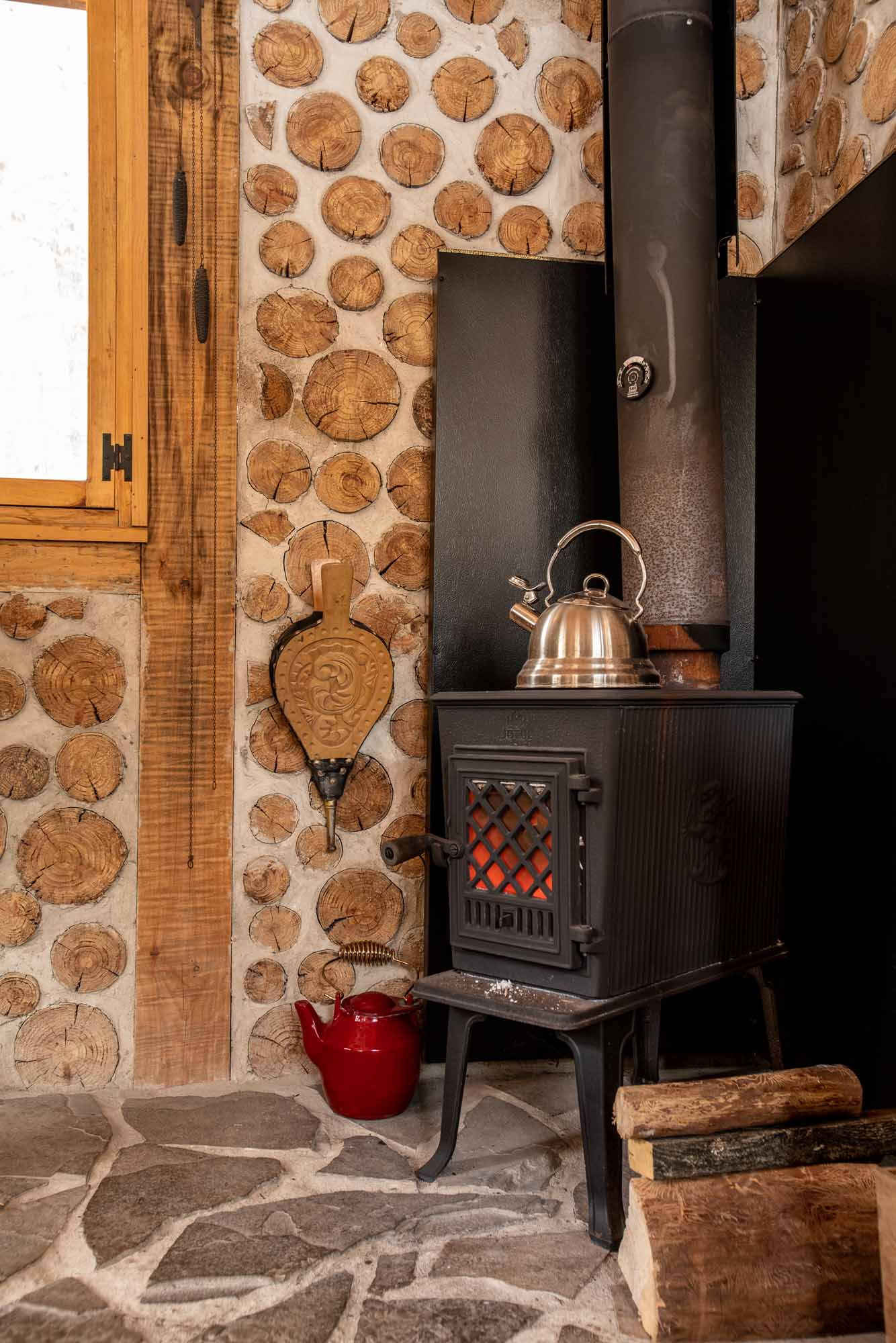 The-Cordwood-Cabin-An-Accessible-Retreat-from-the-21st-Century-woodstove-photo-by-Kristin-Schnelten